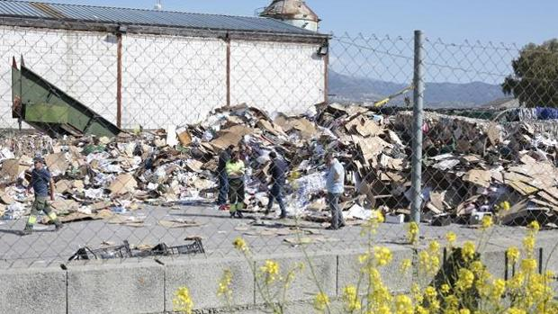 El cadáver ha sido encontrado en una planta de reciclaje de cartón de Granada.