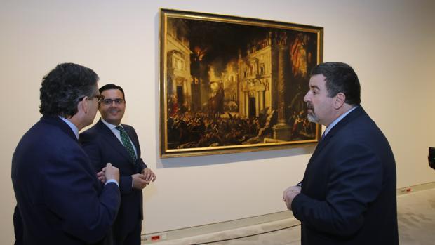 Úbeda de los Cobos, Roiz y Pérez Suescun junto a «El incendio de Troya», de Francisco Collantes